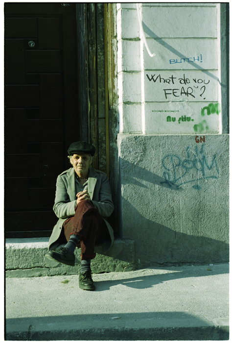 a man sitting on doorstep in bucharest city hist ursu mihail