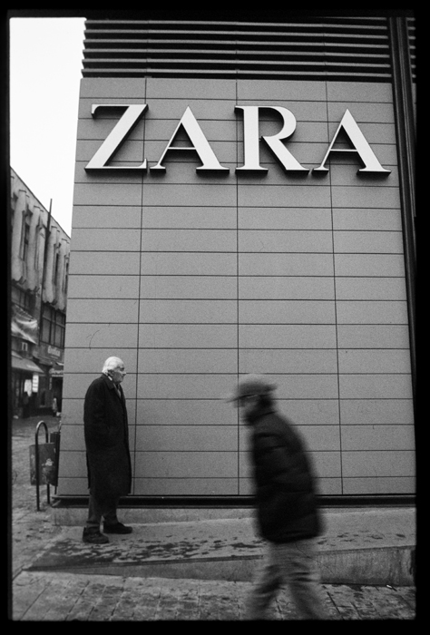 an old man in front of the zara shop author ursu mihail