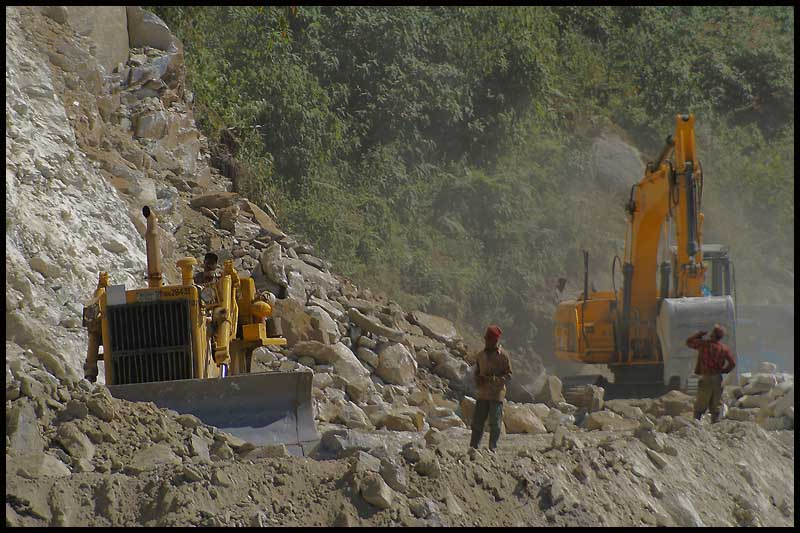 clearing a rockslide on mountain highway autho downs jim