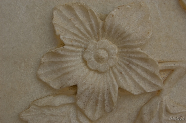 flower carved in the white marble of taj mahal au chakraborty debejyo