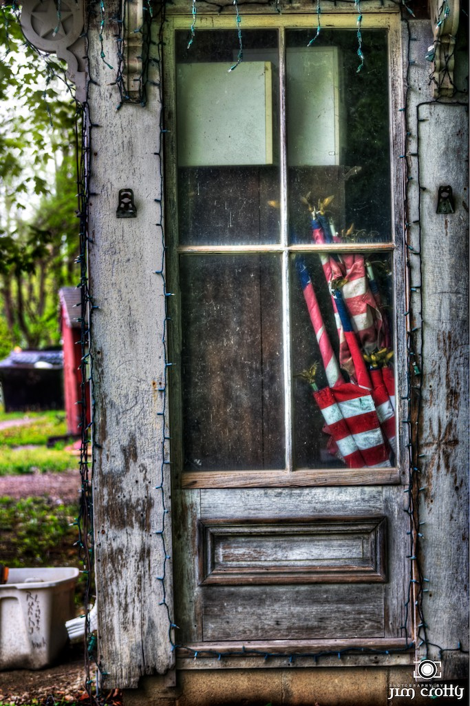 flags in old doorway author crotty jim