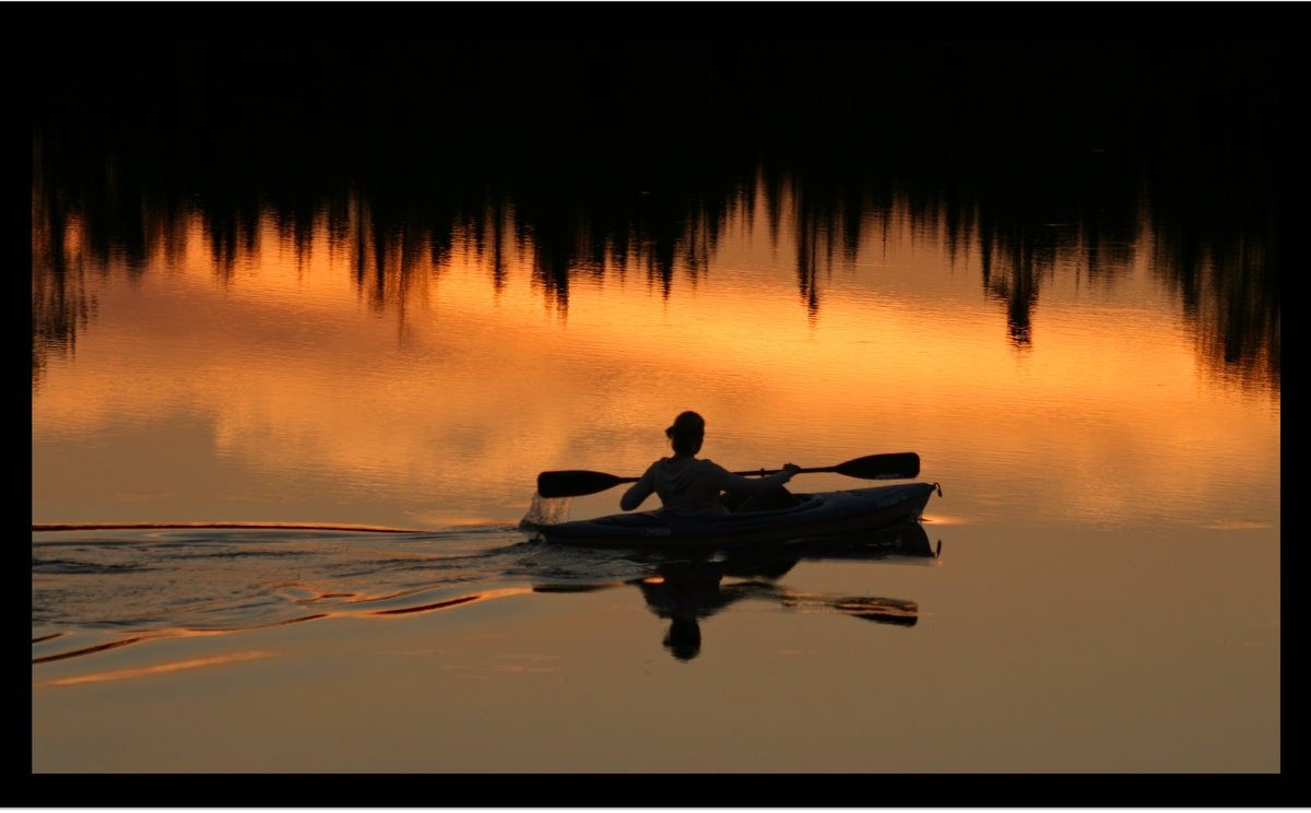 a lone kayaker at sunset author pluskwik paul