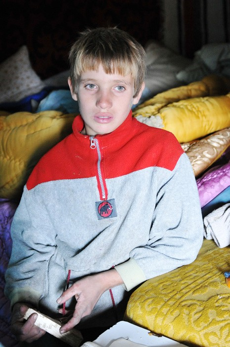 a boy in his temporary house where he lives with h ursu mihail