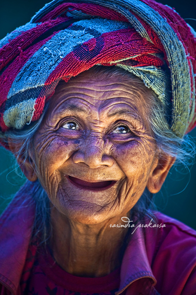 an old balinese woman with her joyous face autho prakarsa rarindra