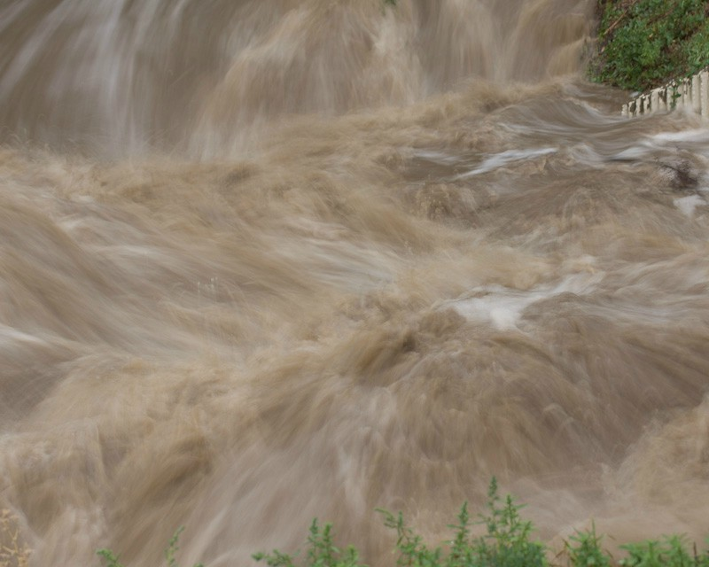colorado floods rush thru a culvert author do downs jim