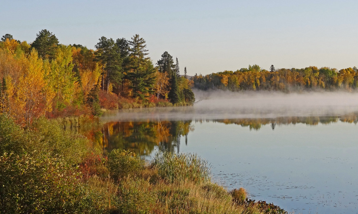 foggy fall morning across four mile lake author p pluskwik paul
