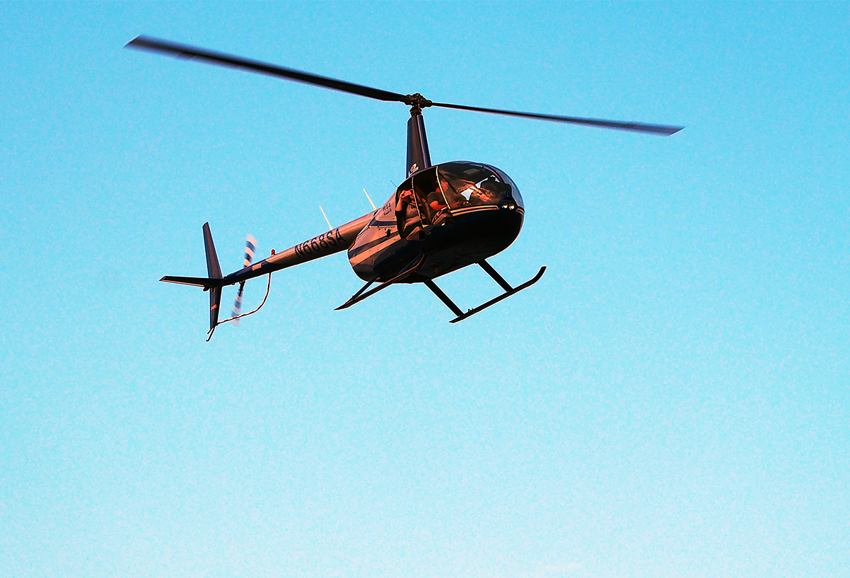 helicopter over parade author hull ray