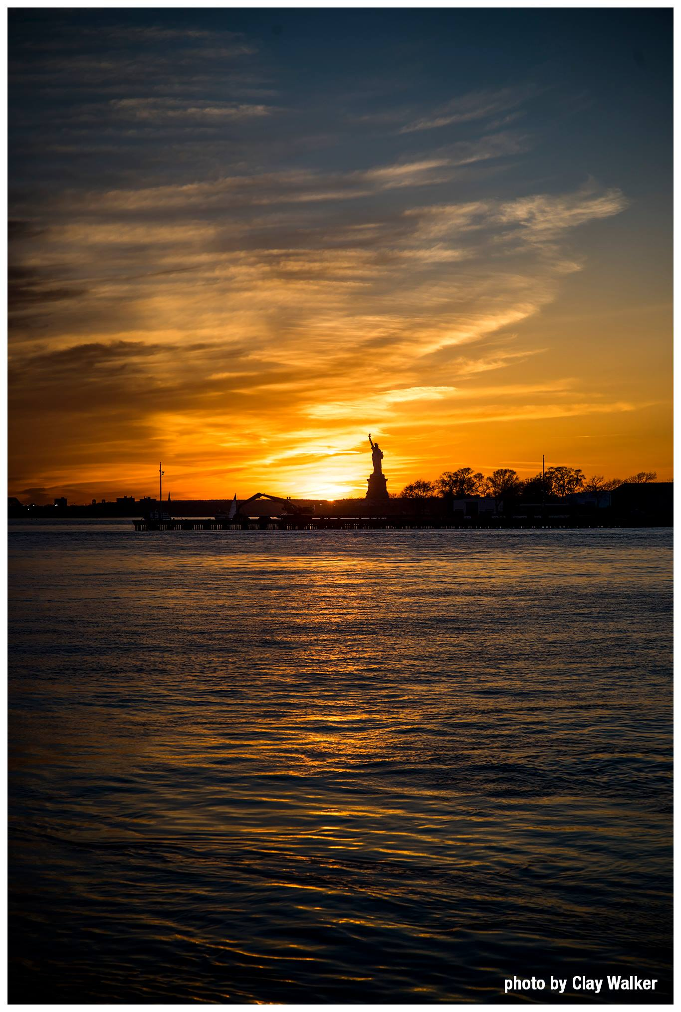 last ray of sunlight on the statue liberty red walker clay
