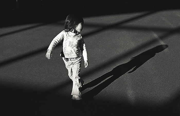 girl watching her shadow author ray