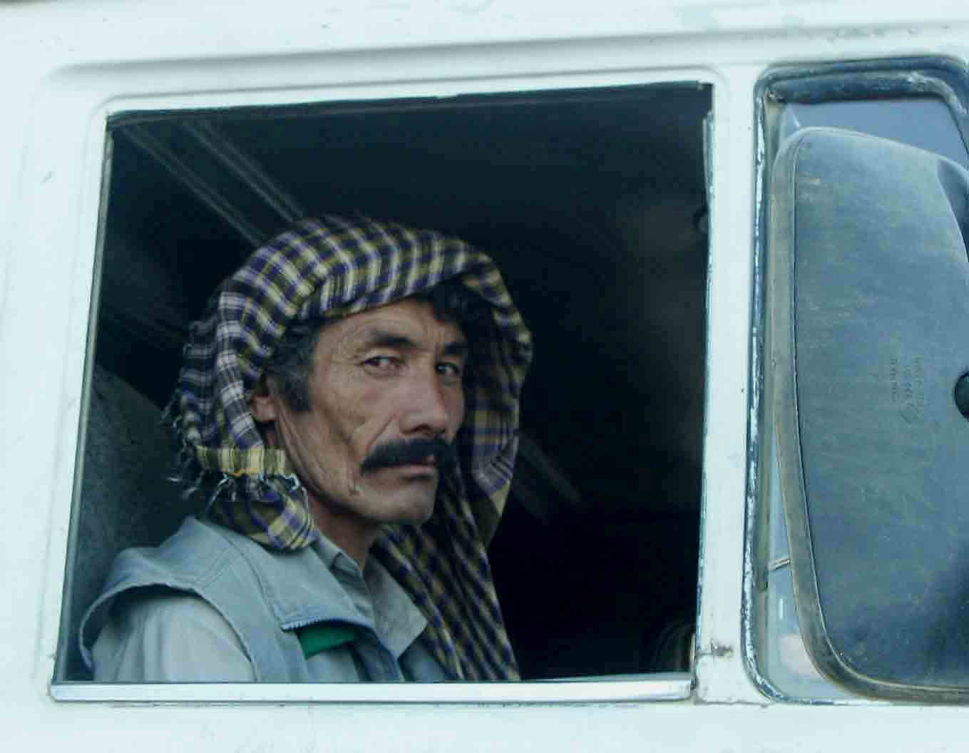 relief driver riding shotgun on an afghani big rig downs jim