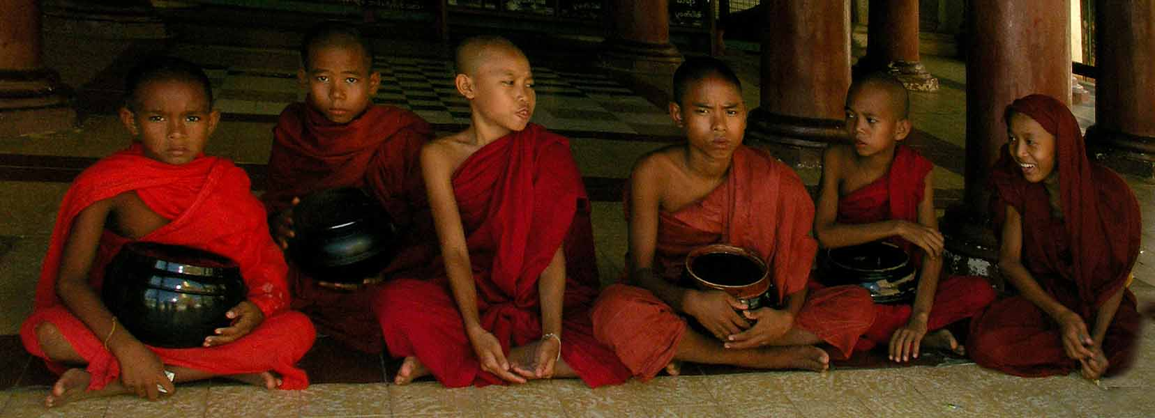 mini monks with their beggar bowls in the recesses downs jim