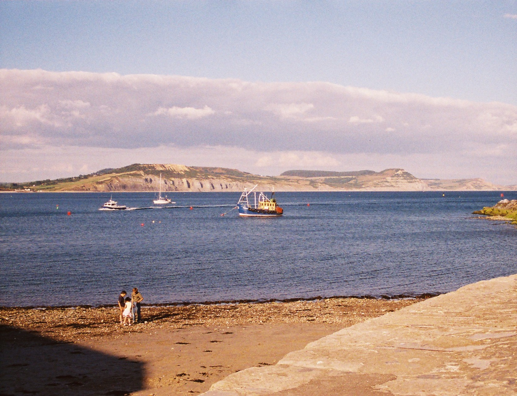 view from lyme harbour to charmouth and golden cap rance ian
