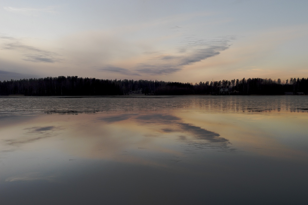 symmetrical forms reflections on a freezing lake soini hannu