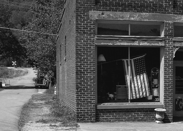 old store with flag author berryhill doug