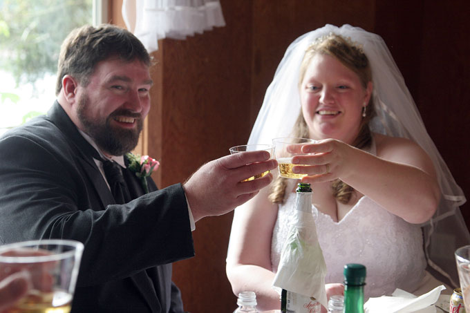 bride and groom toasting author root josh