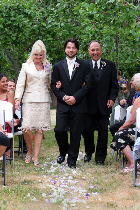 groom walking with his parents author root josh