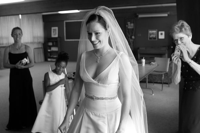 bride smiling at her dress in the mirror author root josh