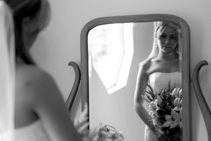 bride looking at herself in the mirror author ro root josh