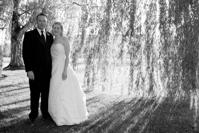 bride and groom under a large willow author root josh