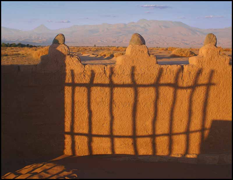 fence on a wall at sunset author downs jim
