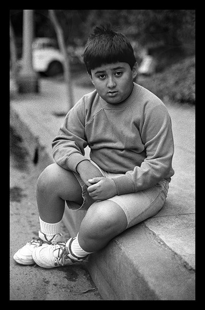 child sitting on curb author walker clay