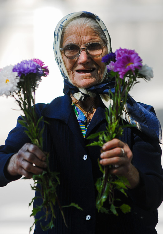 an old woman selling flowers in chisinau author u ursu mihail