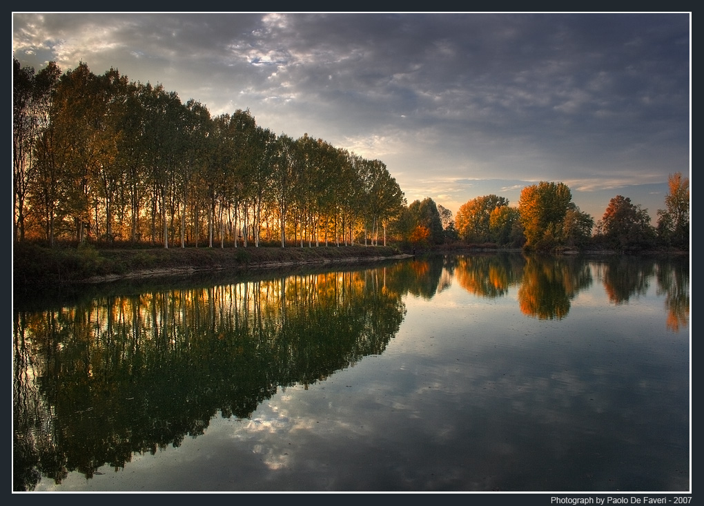 the po river at sunset author de faveri paolo