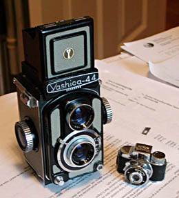 mycro camera next to x tlr miniature author day don