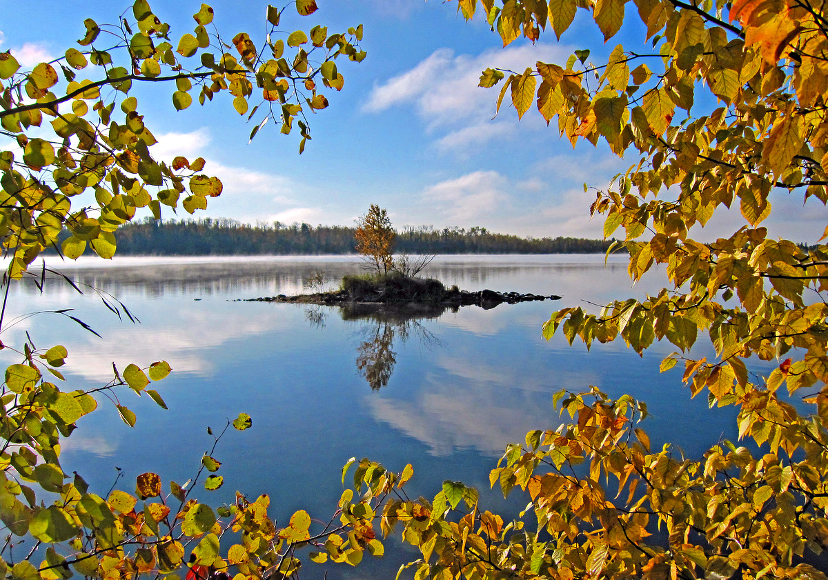 small island framed in by fall color author plusk pluskwik paul