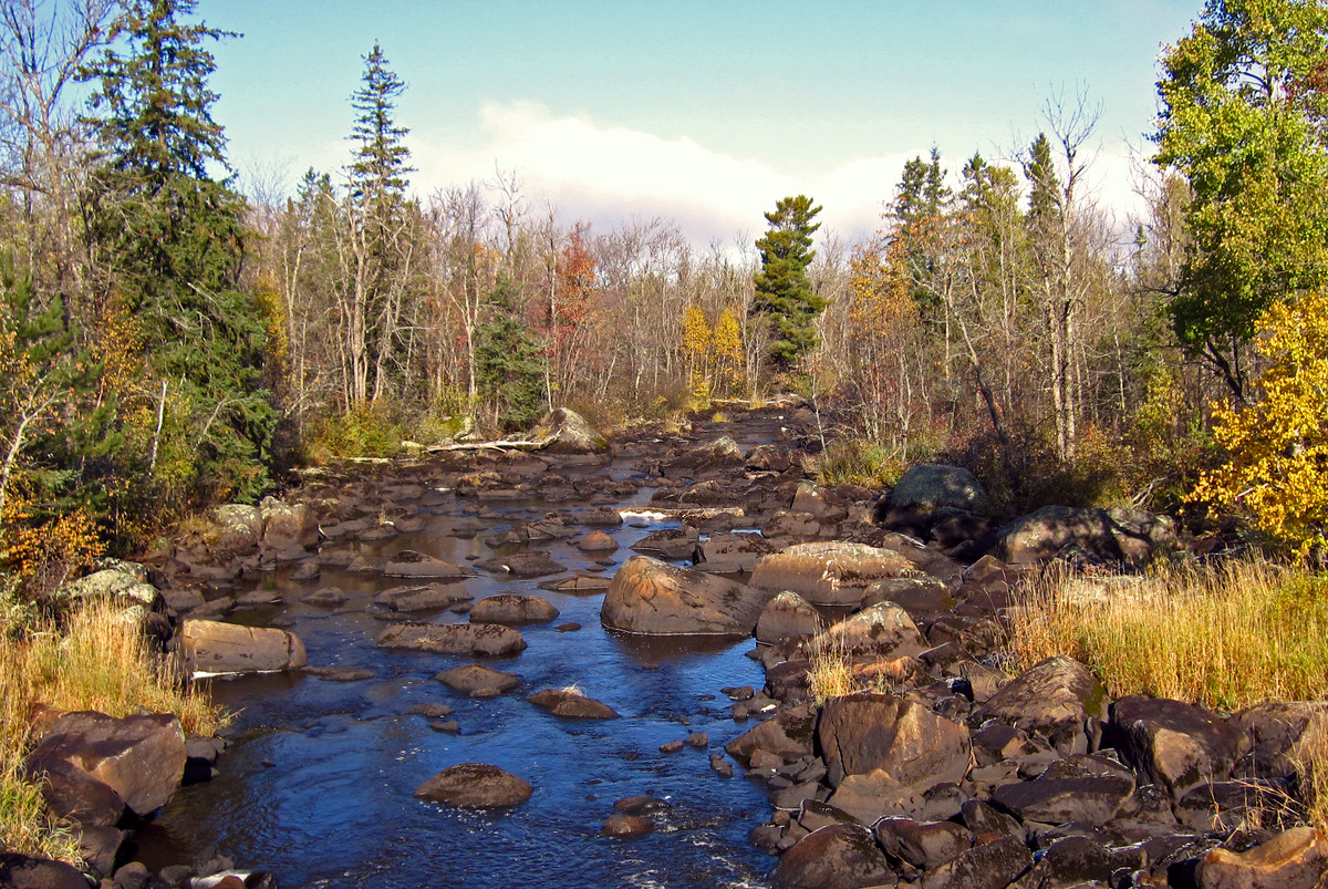 blue sky and fall color along the partridge river pluskwik paul